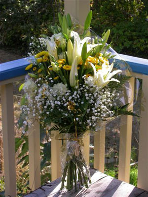 European Hand Tied Bouquet of white oriental lilies, lisianthus, golden button mums, baby's breath