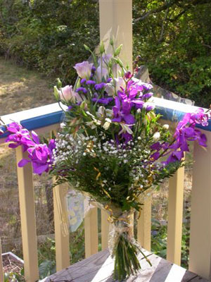 European Hand Tied Bouquet of  mountain blue mokara orchids, alstromaeria, lisianthus, ageratum