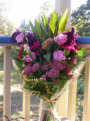 European Handtied Bouquet of tropical foliages, lisianthus, amaranthus, sedum, germinis, celosia cristata