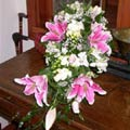 Traditional Cascade Wedding Bouquet of sorbonne lilies, roses, alstromaeria, freesia